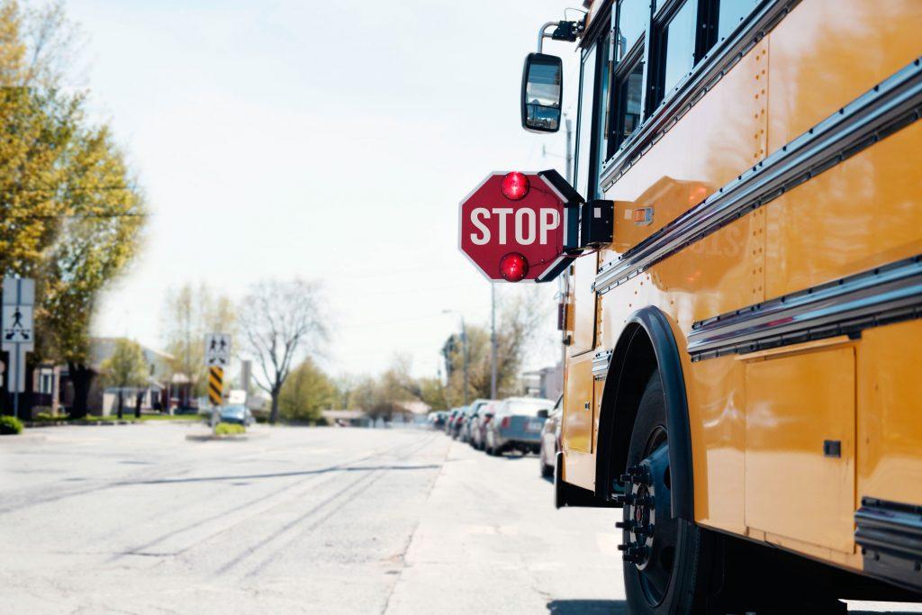 School bus on neighborhood street.
